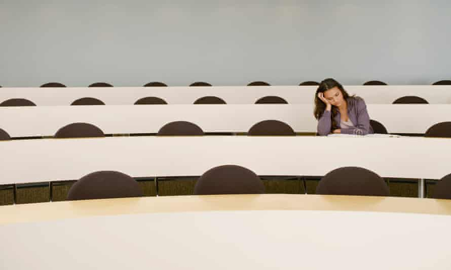 woman alone in lecture hall