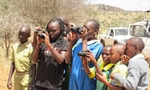 On safari during the Kids Twiga Rally. Giraffe count in Laikipia County, Kenya, March 2016.