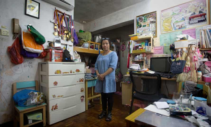 Hoi Kwan, 50, lives in a 300 sq ft apartment with her two children in Macau's Santo Antonio district, Macau