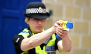 An officer uses an X26 Taser electrical weapon at a training unit.