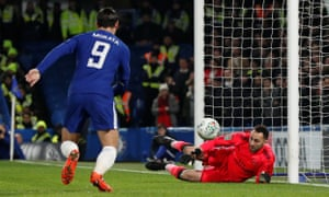 Chelsea's Alvaro Morata charges in after Arsenal keeper David Ospina initial save.