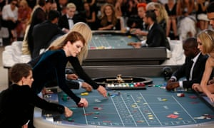 Actors Kristen Stewart and Julianne Moore join the high rollers at a 2015 show