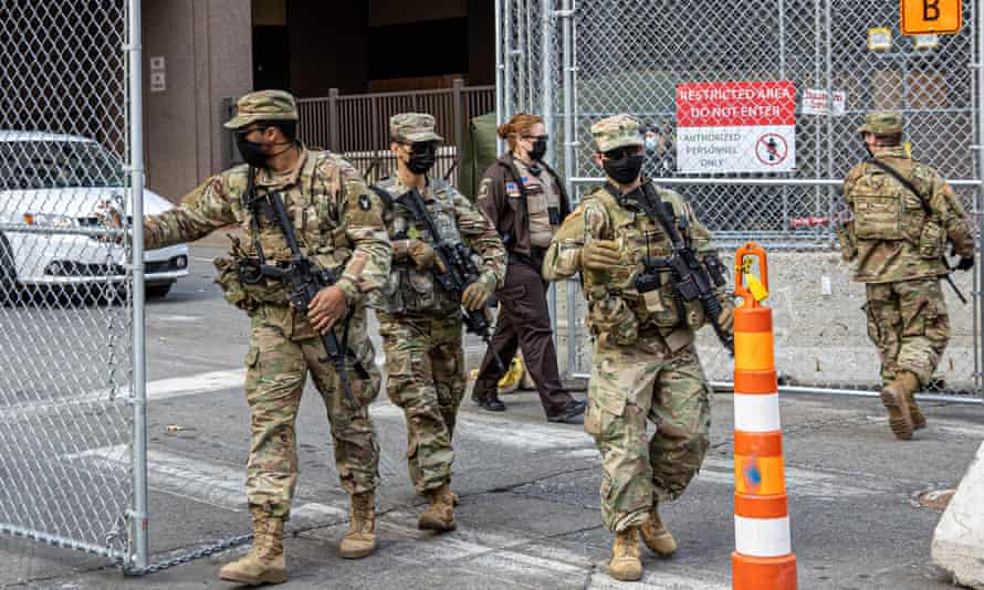 Members of the National Guard open a security gate outside the Hennepin County Government Center on March 9, 2021 in Minneapolis, Minnesota.