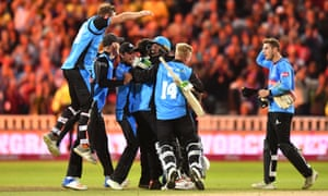 Worcestershire Rapids' Ben Cox is mobbed by his teammates.