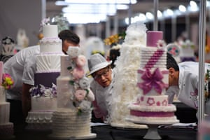 Judges inspect wedding cakes