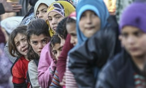 Citizens of Aleppo at the Turkish border.
