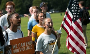 Young activists march to Smith & Wesson's headquarters in Springfield, MA. Amnesty said Congress should pass a law to stop carrying guns in public 'unless there is a credible justification for doing.'