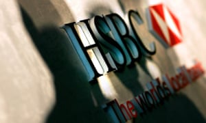 Shadows are cast over an HSBC logo in London