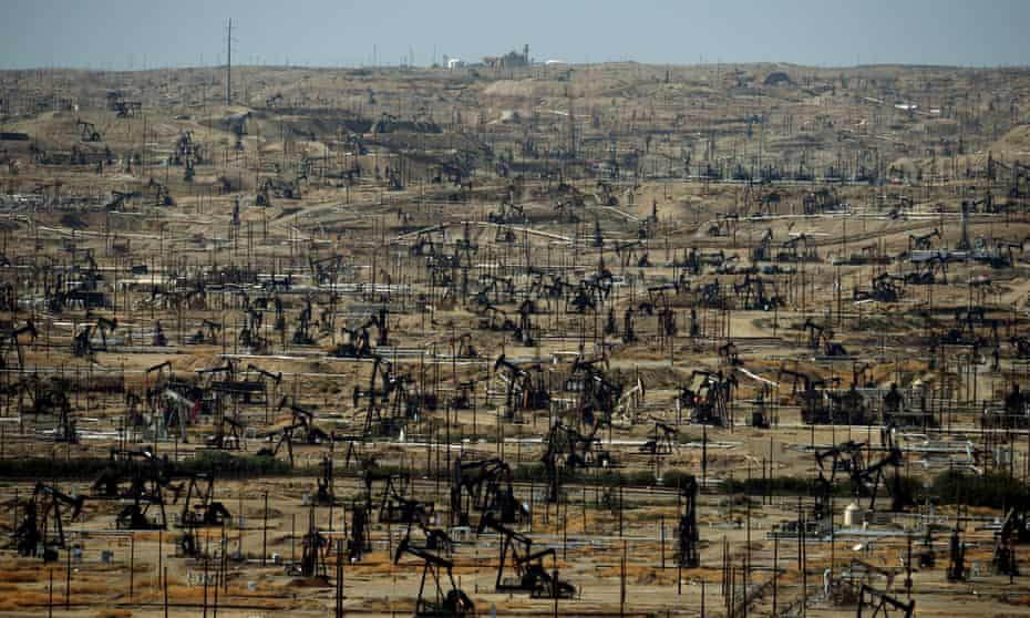 Oil pumping jacks and drilling pads close to Bakersfield, California.