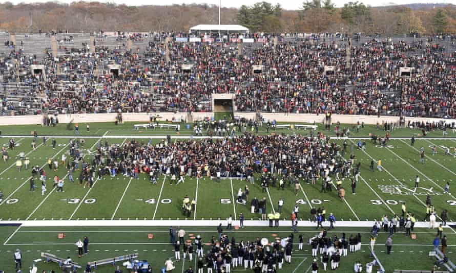 Students stage a fossil fuel protest delaying the start of the second half of the Harvard-Yale game in New Haven, Connecticut, on 23 November.