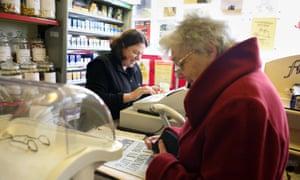 Elderly woman and shopkeeper