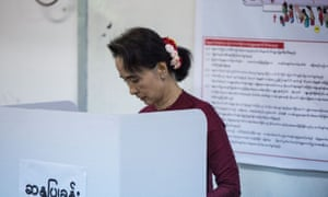 Aung San Suu Kyi, the Myanmar opposition politician, casts her vote during the first free and fair election for decades on Sunday.