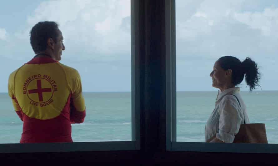Clara takes a daily swim in the sea – and flirts with the lifeguard