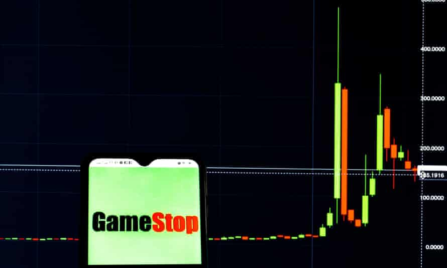 In this photo illustration, a GameStop Corporation logo seen displayed on a smartphone with the stock market information of GameStop Corporation in the background
