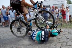 Bora Hansgrohe team rider Rafał Majka and AG2R La Mondiale team rider Olivier Naesen come a cropper on the cobbles