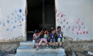 Children sit on stairs in the refugee camp of Lagadikia, Greece.
