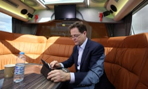 Liberal Democrat party leader Nick Clegg works on the party's campaign bus after visiting Watford.