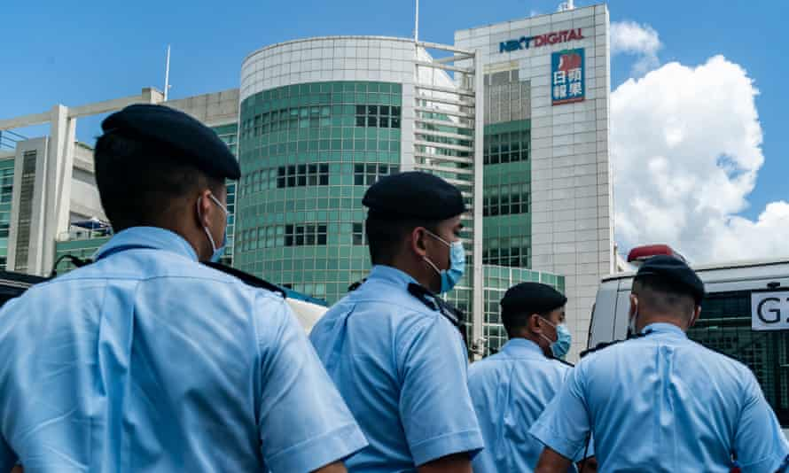 Police outside Next Digital's offices in Hong Kong  in June