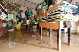 A man cleans his flooded garage in Los Alcazares, Murcia, in south-east Spain