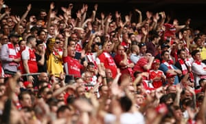 The Arsenal fans wave off Victor Moses.
