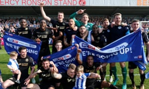 The Wigan players celebrate after their 4-0 win at Fleetwood Town sealed their return to the Championship.
