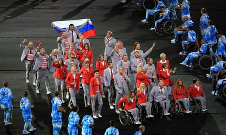The Belarus team with a delegation member waving a Russian flag during the opening ceremony of the 2016 Rio Paralympic Games at the Maracanã