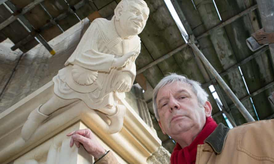 Richard Shephard with a grotesque carved in his likeness on the east side of York Minster, overlooking the choir school of which he was a former headteacher, on his retirement as the Minster's director of development and chamberlain in 2015.
