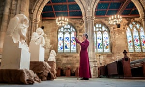 Alison White blesses statues of characters from The Chronicles of Narnia by CS Lewis