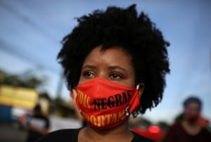 """Manaus, Brazil A woman joins an anti-racism """"Black and Indigenous Lives Matter"""" demonstration"""