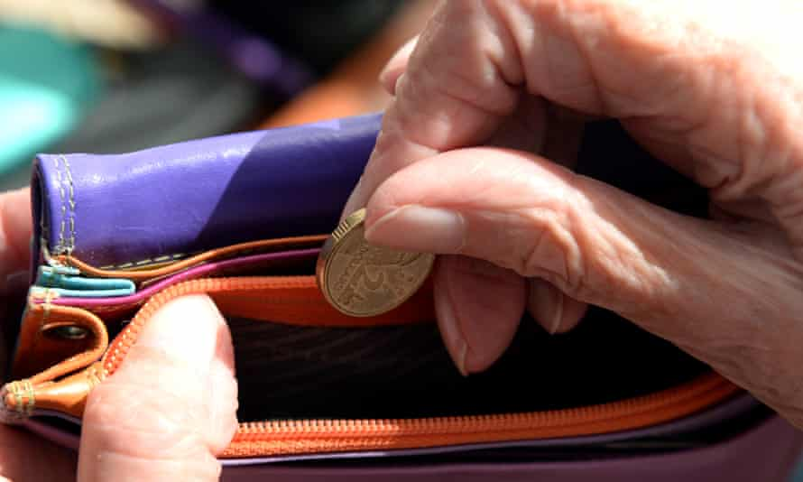 An Australian dollar coin is taken out of a purse. Canberra, 8 April 2014.