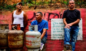 Locals line up to replace empty propane gas drums in Las Minas de Baruta neighborhood, Caracas, on Thursday.