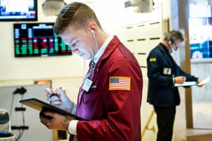 Traders work on the floor of the New York Stock Exchange today