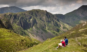 Walkers check a map by Hay Stacks, Cumbria.