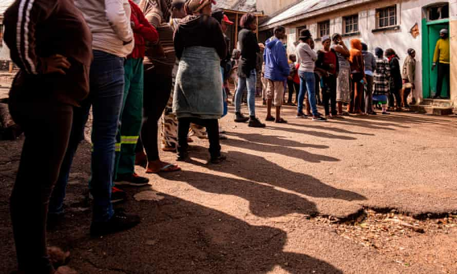 South Africans living in lockdown queue for food.