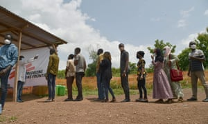 Ivory Coast Ministry of Health workers measures the body temperatures of passengers as a preventive measure against the spread of the Covid-19 coronavirus at a checkpoint at the entrance of Bouaké on June 25, 2020.