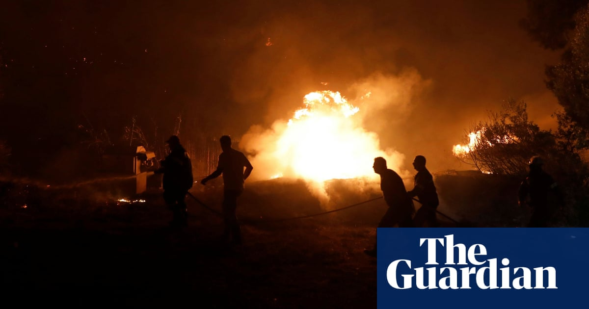 Greece fires: 150 houses destroyed by wildfires as monks refuse to leave stricken island
