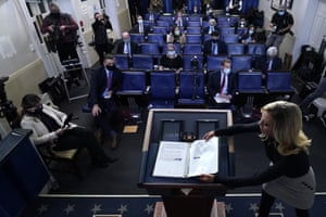 White House press secretary Kayleigh McEnany closes a notebook Donald Trump used after he spoke at the White House.