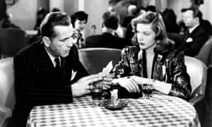Humphrey Bogart as Philip Marlowe in The Big Sleep (1946) with Lauren Bacall.