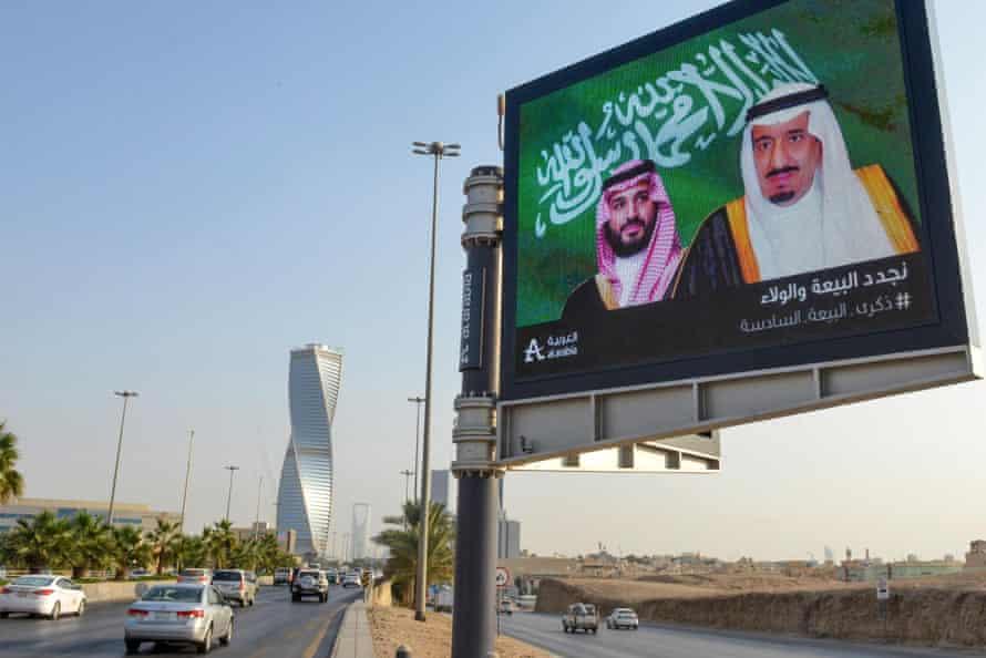 An electronic billboard bearing the portraits of King Salman bin Abdulaziz Al Saud (right) and his son Mohammed bin Salman in Riyadh