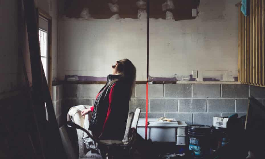 Tricia Campbell McAvoy looks for mold in the garage of her home in Brick, New Jersey.