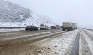 Traffic stopped on Interstate 5 where it has been closed due to snow in the Tehachapi mountains of southern California.