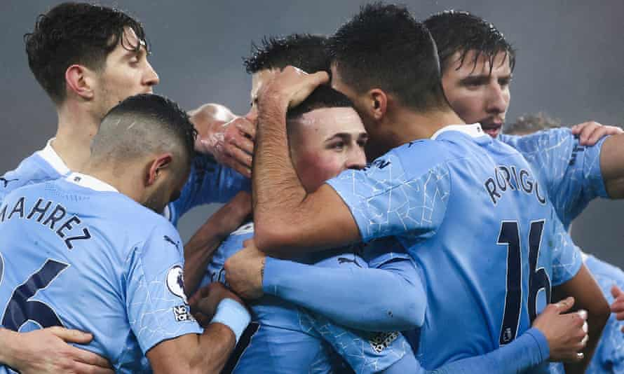 Manchester City's Phil Foden is the centre of attention after scoring against Brighton
