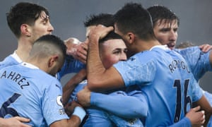 Phil Foden is mobbed after scoring what turned out to be the winning goal.