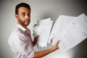 Guardian Australia journalist Paul Farrell displays his police files compiled by Australian federal police