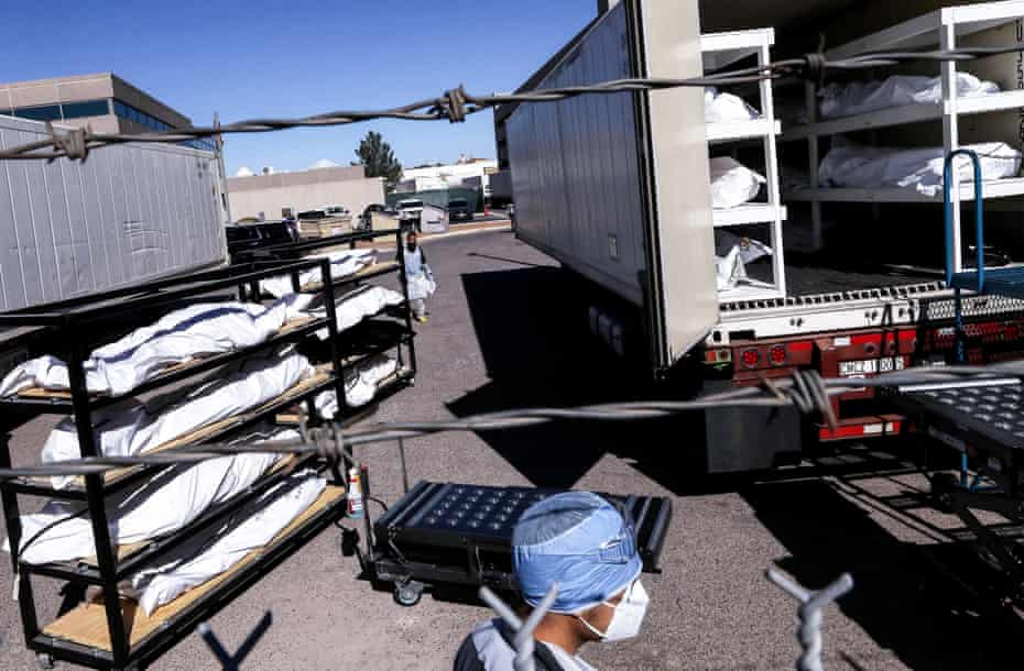 An inmate from El Paso county detention facility prepares to load bodies into a refrigerated temporary morgue in Texas on 16 November.