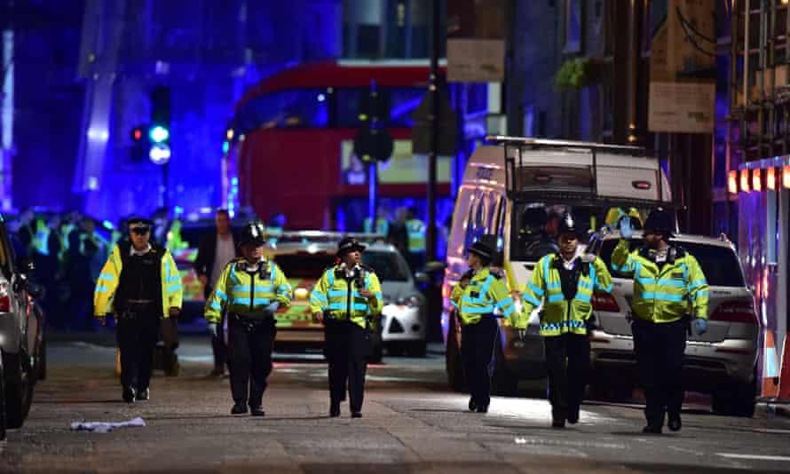 Police officers investigate the terrorist attack on Borough Market, London, 3 June 2017