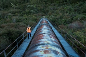 Genesis Energy ecologist Campbell Speedy walks along a large pipe that carries water to the Tongariro power scheme
