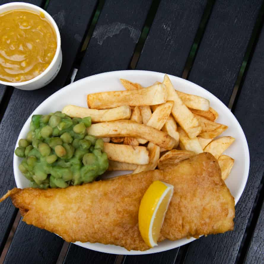Fish, chips mushy peas, wedge of lemon, pleasingly orange curry sauce at Angel Lane Chippie.