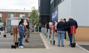Shoppers queue outside a Wickes DIY stores in Staines-upon-Thames, Surrey