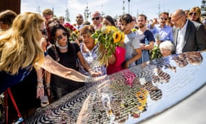 Relatives of those who died on MH17 attend the unveiling ceremony a monument to victims near Amsterdam's Schiphol airport.